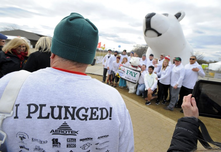Corporate Plungers get ready for their plunge. (Lloyd Fox/Baltimore Sun)