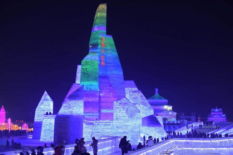 People visit ice sculptures illuminated by colored lights at the Harbin Ice and Snow Festival to celebrate the new year in Harbin on January 4, 2017. (NICOLAS ASFOURI/AFP/Getty Images)