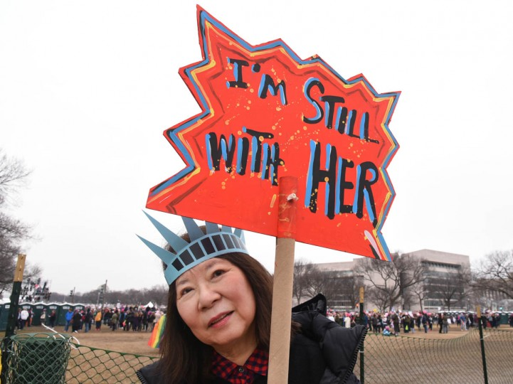 "Barbara Takenaga, of New York City, holding a sign that reads, ""I'M STILL WITH HER,"" said ""I'm demonstrating against Trump, a Fascist and a sexist. Takenaga added, ""He is not my president."" (Amy Davis/Baltimore Sun)"