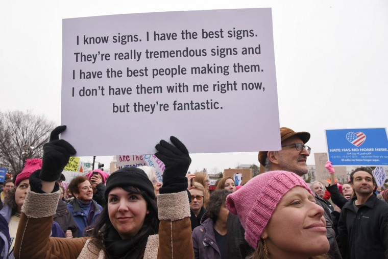 """Ell Farnon, 46, of San Francisco, participating in the Women's March on Washington with a sign inspired by Trump comments, said, """"I never thought I would have to be here doing this."""" (Amy Davis/Baltimore Sun)"""