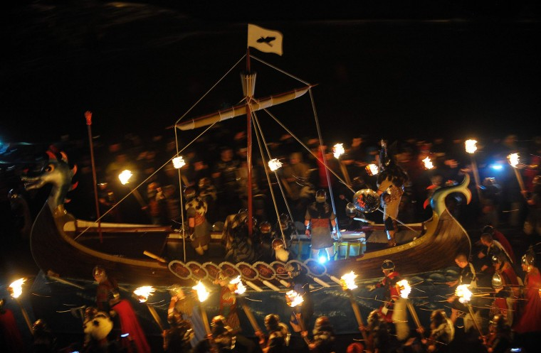 Participants dressed as Vikings in prepare to burn their viking galley ship at the culmination of the annual Up Helly Aa festival in Lerwick, Shetland Islands, on January 31, 2017. Up Helly Aa celebrates the influence of the Scandinavian Vikings in the Shetland Islands and culminates with up to 1,000 'guizers' (men in costume) throwing flaming torches into their Viking longboat and setting it alight later in the evening. (Andy Buchanan/AFP/Getty Images)