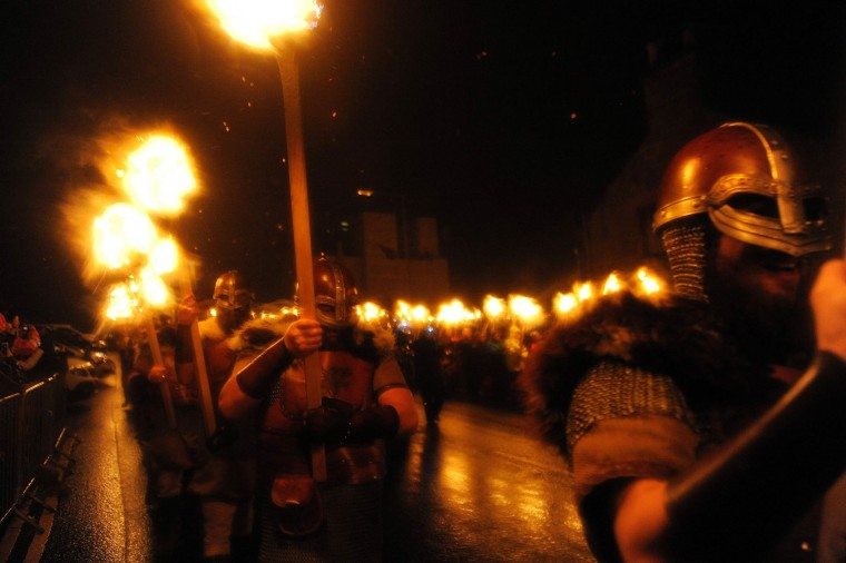 Participants dressed as Vikings carry torches as they march in procession before burning their viking galley ship at the culmination of the annual Up Helly Aa festival in Lerwick, Shetland Islands, on January 31, 2017. Up Helly Aa celebrates the influence of the Scandinavian Vikings in the Shetland Islands and culminates with up to 1,000 'guizers' (men in costume) throwing flaming torches into their Viking longboat and setting it alight later in the evening. (Andy Buchanan/AFP/Getty Images)