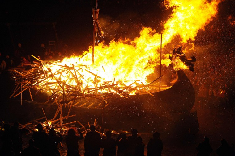 Participants dressed as Vikings burn their viking galley ship at the culmination of the annual Up Helly Aa festival in Lerwick, Shetland Islands, on January 31, 2017. Up Helly Aa celebrates the influence of the Scandinavian Vikings in the Shetland Islands and culminates with up to 1,000 'guizers' (men in costume) throwing flaming torches into their Viking longboat and setting it alight later in the evening. (Andy Buchanan/AFP/Getty Images)