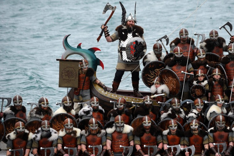Participants dressed as Vikings pose by a long boat in the annual Up Helly Aa festival in Lerwick, Shetland Islands, on January 31, 2017. Up Helly Aa celebrates the influence of the Scandinavian Vikings in the Shetland Islands and culminates with up to 1,000 'guizers' (men in costume) throwing flaming torches into their Viking longboat and setting it alight later in the evening. (Andy Buchanan/AFP/Getty Images)