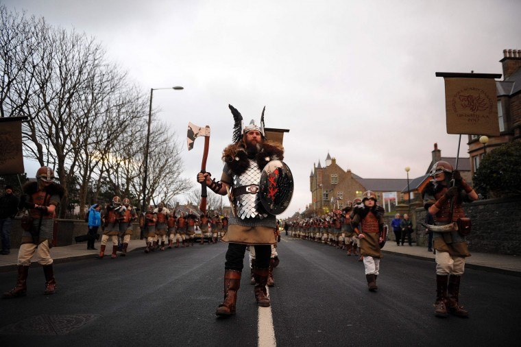 Participants dressed as Vikings march down a street in the annual Up Helly Aa festival in Lerwick, Shetland Islands, on January 31, 2017. Up Helly Aa celebrates the influence of the Scandinavian Vikings in the Shetland Islands and culminates with up to 1,000 'guizers' (men in costume) throwing flaming torches into their Viking longboat and setting it alight later in the evening. (Andy Buchanan/AFP/Getty Images)