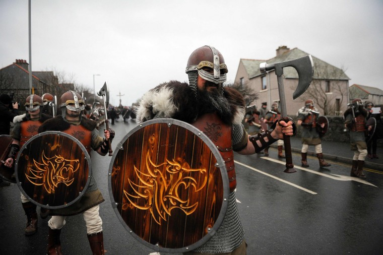 Participants dressed as Vikings participate in the annual Up Helly Aa festival in Lerwick, Shetland Islands, on January 31, 2017. Up Helly Aa celebrates the influence of the Scandinavian Vikings in the Shetland Islands and culminates with up to 1,000 'guizers' (men in costume) throwing flaming torches into their Viking longboat and setting it alight later in the evening. (Andy Buchanan/AFP/Getty Images)