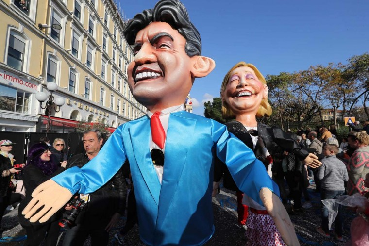 "Artists dressed up with costumes depicting French presidential election candidate for the far-left coalition ""La France insoumise"", Jean-Luc Melenchon (L) and candidate for the far-right Front National (FN) party Marine Le Pen parade in the streets of Nice during the 133rd edition of the Nice Carnival on February 19, 2017 in Nice, southeastern France. The Nice carnival runs until February 25, 2017 under the theme ""The King of Energies"". (VALERY HACHE/AFP/Getty Images)"