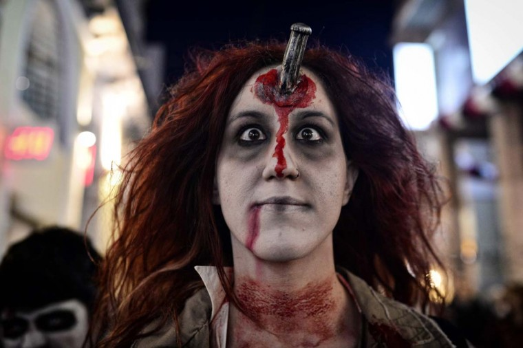 A woman poses as she takes part in the Zombie Walk during carnival celebrations in the Greek capital Athens on February 25, 2017. (LOUISA GOULIAMAKI/AFP/Getty Images)