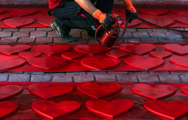 An Iraqi Kurdish man spray-paints hearts in anticipation for Valentine's Day, in a street in Arbil, the capital of the Kurdish autonomous region in northern Iraq, on February 12, 2017. (SAFIN HAMED/AFP/Getty Images)