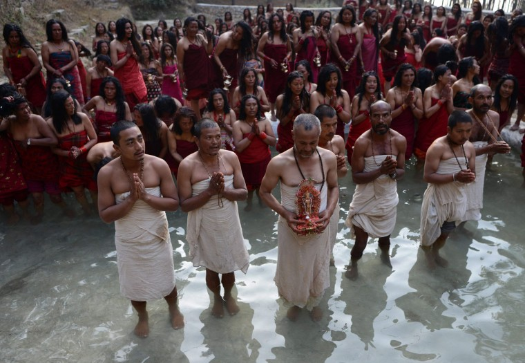 Nepalese Hindu devotees led by priests take part in a mass bathing ritual during the month-long Swasthani Festival in Changu Narayan at Bhaktapur, on the outskirts of Kathmandu on February 8, 2017. Hundreds of married and unmarried women in the Himalayan nation are marking the month-long fast in the hope of a prosperous life and conjugal happiness. (Prakash Mathema/AFP/Getty Images)