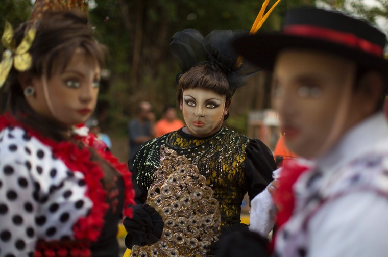 "Dancers dressed as traditional characters in the ""Baile de Negras"" dance take part in the celebration of the feast day of the Virgin of the Candelaria (Candlemas) in the town of Diriomo, some 45 km from Managua, Nicaragua on February 2, 2017. Candlemas falls forty days after Christmas and is celebrated by Catholics as the presentation of Christ at the Temple. (AFP Photo/Inti Ocon)"