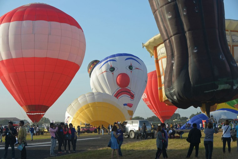 Balloon enthusiasts prepare to take flight during the annual International Hot Air Balloon Festival at the former Clark US Air Force base in Pampanga province, north of Manila on February 9, 2017. Some 29 balloon enthusiasts from around the globe are participating in the event which runs February 9 to 12. (TED ALJIBE/AFP/Getty Images)