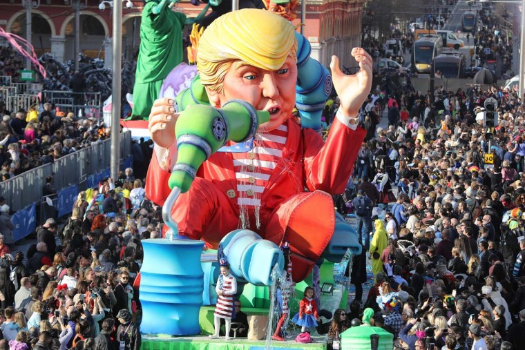 "People look at the float ""Wind of Change"" depicting US President Donald Trump as it parades in the streets of Nice for the 133rd edition of the Nice Carnival on February 19, 2017 in Nice, southeastern France. The Nice carnival runs until February 25, 2017 under the theme ""The King of Energies"". (VALERY HACHE/AFP/Getty Images)"