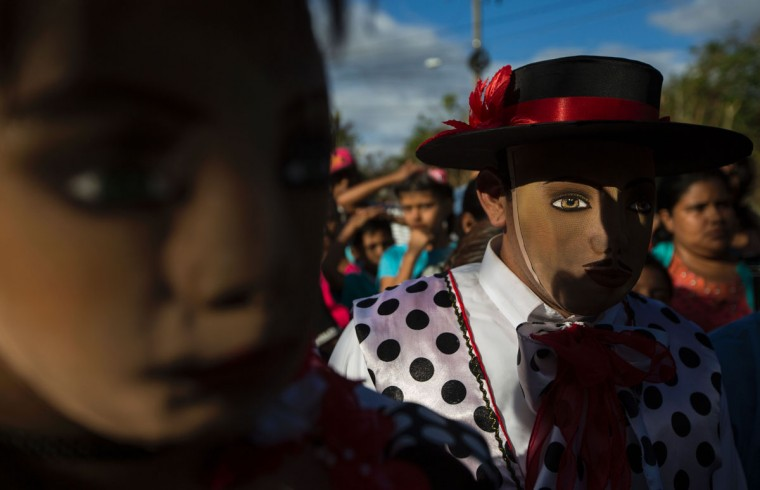 "Men dressed as traditional characters in the ""Baile de Negras"" get ready to dance on the feast day of the Virgin of the Candelaria (Candlemas) in the town of Diriomo, some 45 km from Managua, Nicaragua on February 2, 2017. Candlemas falls forty days after Christmas and is celebrated by Catholics as the presentation of Christ at the Temple. (AFP Photo/Inti Ocon)"