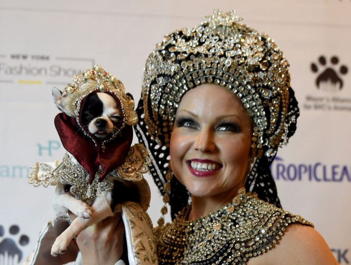 Summer Strand and her dog April Moon dressed in the fashion of Russia and a contestant in the World Fashion Presents poses during the 14th Annual New York Pet Fashion Show presented by TropiClean at the Hotel Pennsylvania February 9, 2017. (TIMOTHY A. CLARY/AFP/Getty Images)