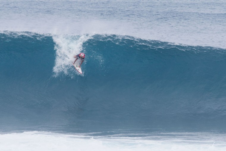 2017 World Champion John John Florence takes off on a perfect barrel during the 2017 Volcom Pipe pro at Pipeline February 4, 2017, on the North shore of Oahu Island in Hawaii. (AFP PHOTO / brian bielmann)