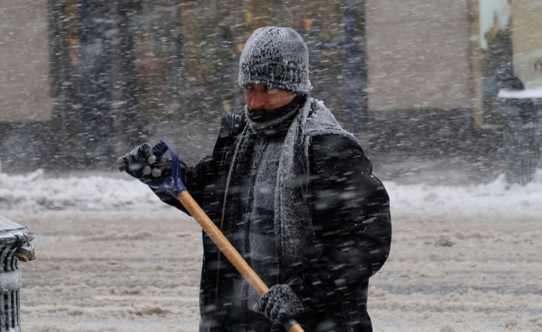 A man cleans snow from a street during a winter storm in New York on February 9, 2017. A heavy winter snow storm lashed the northeastern United States Thursday, subjecting New York to near blizzard-like conditions and forcing flight cancellations as schools and the United Nations closed. (Jewel Samad/AFP/Getty Images)