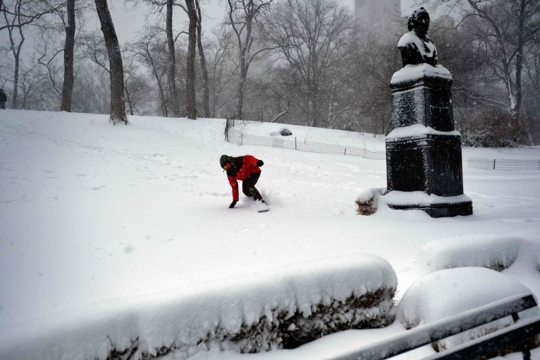 A man snowboards on a slope at the Central Park during a winter storm in New York on February 9, 2017. A heavy winter snow storm lashed the northeastern United States Thursday, subjecting New York to near blizzard-like conditions and forcing flight cancellations as schools and the United Nations closed. (Jewel Samad/AFP/Getty Images)