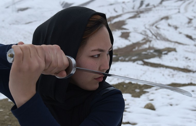 In this photograph taken on January 29, 2017, an Afghan member of a wushu martial arts group poses for a photograph at the Shahrak Haji Nabi hilltop overlooking Kabul. Afghanistan's first female wushu trainer, Sima Azimi, 20, is training 20 Afghan girls aged between 14 - 20 at a wushu club in Kabul, after learning the sport while living as a refugee in Iran. (WAKIL KOHSAR/AFP/Getty Images)