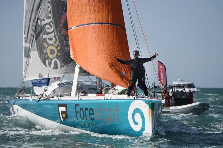 "New Zealand's skipper Conrad Colman celebrates on his Imoca 60 monohull ""Foresight Natural Energy"" upon his arrival in Les Sables-d'Olonne, western France, at the end of the Vendee Globe around-the-world solo sailing race on February 24, 2017. Colman finished 16th. (Jean-Sebastien Evrard/AFP/Getty Images)"