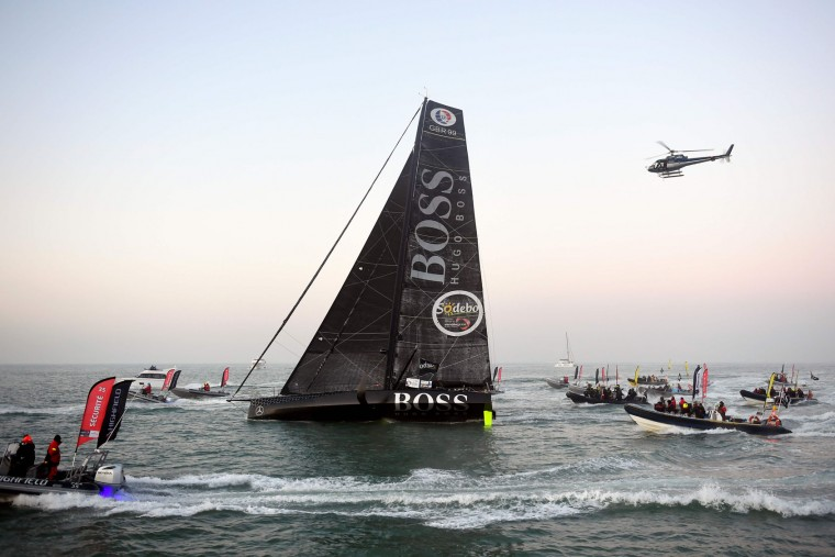 Second-placed British skipper Alex Thomson aboard his Imoca monohull Hugo Boss arrives to cross the finish line of the Vendee Globe solo around the world sailing race, on January 20, 2017 off Les Sables d'Olonne, western France. French skipper Armel Le Cleac'h won the Vendee Globe solo round the world yacht race on January 19, 2017 in a record time. The 39-year-old got the better of his titanic duel with British rival Alex Thomson to cross the finish line at Les Sables d'Olonne at 15:37GMT after 74 days, three hours, 35 minutes and 46 seconds at sea. (Damien Meyer/AFP/Getty Images)