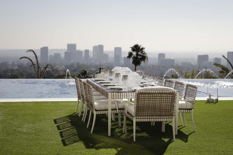 This Thursday, Jan. 26, 2017, photo shows an outdoor dining area next to an 85-foot infinity swimming pool overlooking Los Angeles at a $250 million mansion in the Bel-Air area of Los Angeles. At $250 million, the new mansion in the exclusive Bel-Air neighborhood of Los Angeles is the most expensive home listed in the U.S. (AP Photo/Jae C. Hong)