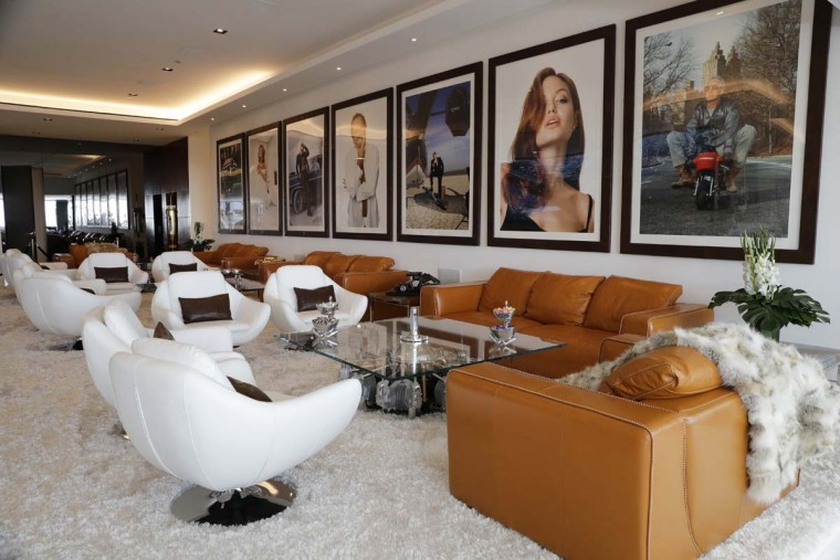 This Thursday, Jan. 26, 2017, photo shows a lounge area decorated with photographs of celebrities at a $250 million mansion in the Bel-Air area of Los Angeles. The mansion, the most expensive home listed in the U.S., includes 12 bedroom suites, 21 bathrooms, five bars, three gourmet kitchens, a spa and an 85-foot infinity swimming pool with stunning views of Los Angeles. (AP Photo/Jae C. Hong)