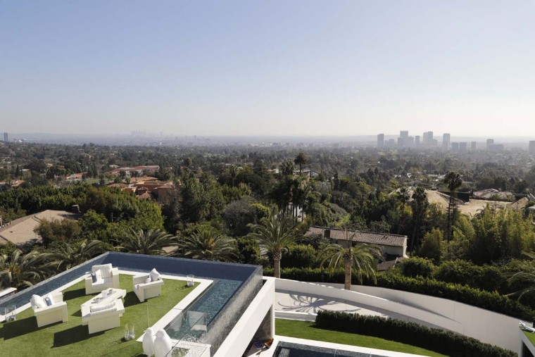 This Thursday, Jan. 26, 2017, photo shows a balcony off the master bedroom of a $250 million mansion overlooking Los Angeles in the Bel-Air area of Los Angeles. The mansion includes 12 bedroom suites, 21 bathrooms, five bars, three gourmet kitchens, a spa and an 85-foot infinity swimming pool with stunning views of Los Angeles. (AP Photo/Jae C. Hong)