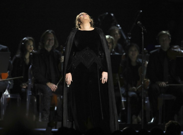 Adele reacts before restarting a performance tribute to George Michael at the 59th annual Grammy Awards on Sunday, Feb. 12, 2017, in Los Angeles. (Photo by Matt Sayles/Invision/AP)