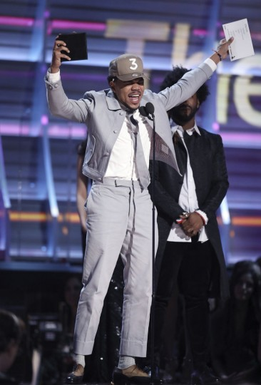 "Chance The Rapper accepts the award for best rap album for ""Coloring Book"" at the 59th annual Grammy Awards on Sunday, Feb. 12, 2017, in Los Angeles. (Photo by Matt Sayles/Invision/AP)"