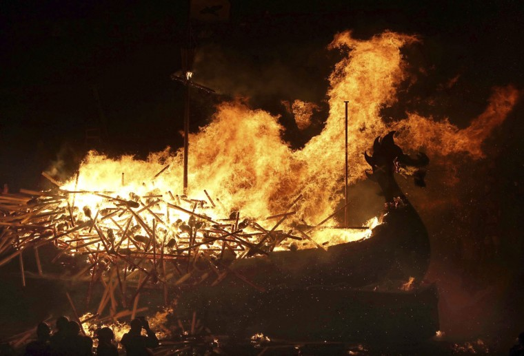 Members of the Jarl Squad set fire to their Viking longship during the Up Helly Aa Viking festival in Lerwick on the Shetland Isles, Scotland, Tuesday Jan. 31, 2017. (Jane Barlow/PA via AP)