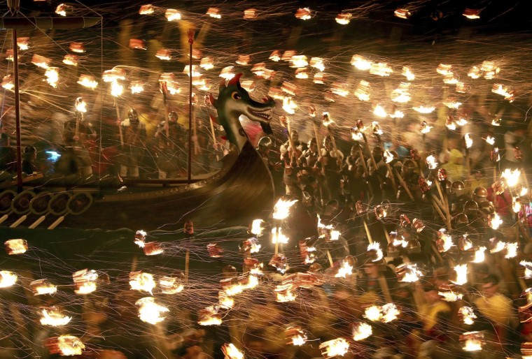Members of the Jarl Squad dressed in Viking costumes carry flaming torches, during the Up Helly Aa Viking festival in Lerwick on the Shetland Isles, Scotland, Tuesday Jan. 31, 2017. (Jane Barlow/PA via AP)