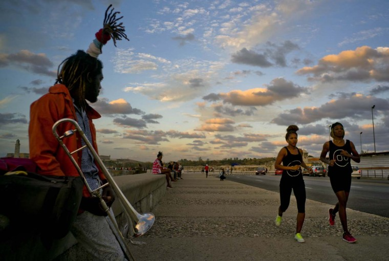 "In this Jan. 30, 2017 photo, boxers Idamerys Moreno, second right, and Legnis Cala, right, run along Havana's Malecon, in Cuba. Moreno and Cala are part of a group of up-and-coming female boxers on the island who want government support to form Cuba's first female boxing team and help dispel a decades-old belief once summed up by a former top coach: ""Cuban women are meant to show the beauty of their face, not receive punches."" (AP Photo/Ramon Espinosa)"