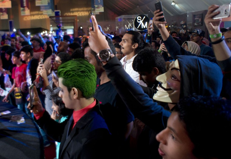 Visitors wear masks as they film a show during the Saudi Comic Con (SCC) which is the first event of its kind to be held in Jiddah, Saudi Arabia, Friday, Feb. 17, 2017. (AP Photo)