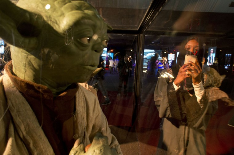A visitor films at the Star War exhibition, an American epic space opera franchise, centered on a film series, during the Saudi Comic Con (SCC) which is the first event of its kind to be held in Jiddah, Saudi Arabia, Friday, Feb. 17, 2017. (AP Photo)