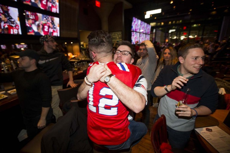 New England Patriots fans celebrate at Tony C's during the fourth quarter after the Patriots tied the score with the Atlanta Falcons during Super Bowl LI, February 5, 2017 in Boston, Massachusetts. (Photo by Scott Eisen/Getty Images)