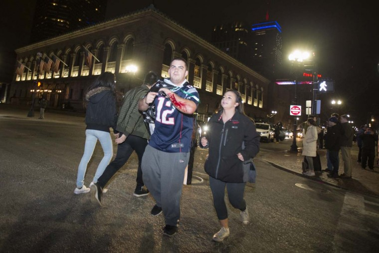 An injured New England Patriots fan celebrates the Patriots' Super Bowl victory against the Atlanta Falcons near the Boston Public Garden. February 5, 2017 in Boston, Massachusetts. (Photo by Scott Eisen/Getty Images)