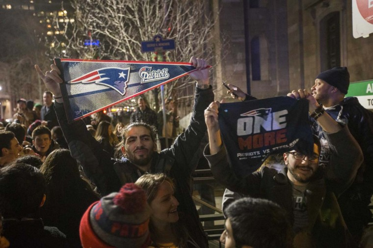 New England Patriots fans celebrate the Patriots' Super Bowl victory against the Atlanta Falcons near the Boston Public Garden. February 5, 2017 in Boston, Massachusetts. (Photo by Scott Eisen/Getty Images)