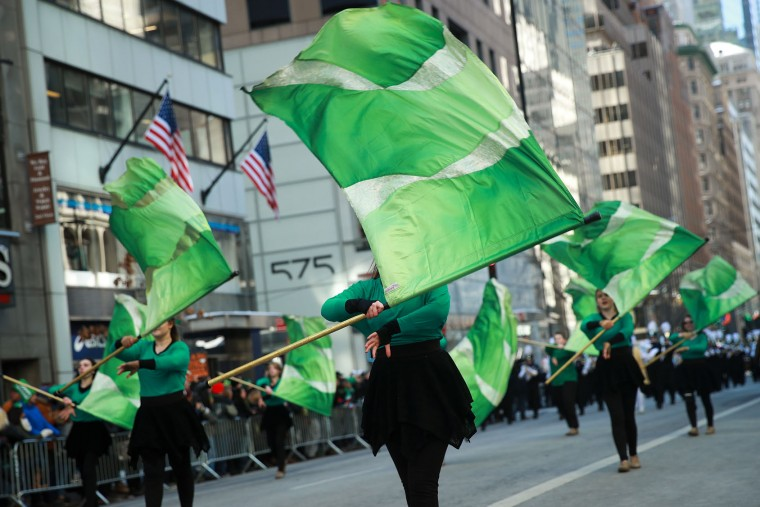 Members of a color guard twirl green flags as they march along 5th Avenue during the annual St. Patrick's Day parade, March 17, 2017 in New York City. The New York City St. Patrick's Day parade, dating back to 1762, is the world's largest St. Patrick's Day celebration. (Photo by Drew Angerer/Getty Images)