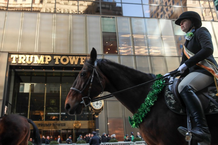 Members of the County Carlow Association ride horses as they march past Trump Tower on 5th Avenue during the annual St. Patrick's Day parade, March 17, 2017 in New York City. The New York City St. Patrick's Day parade, dating back to 1762, is the world's largest St. Patrick's Day celebration. (Photo by Drew Angerer/Getty Images)