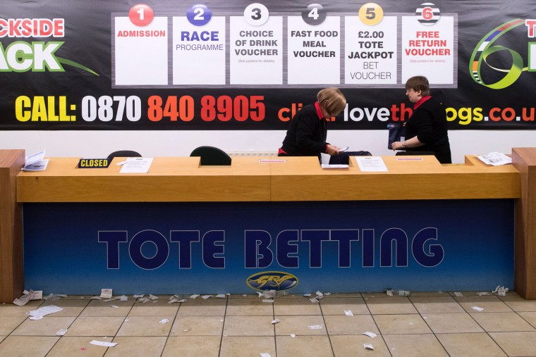 Workers behind the counters get ready to leave after an evening of greyhound racing at the Wimbledon Stadium dog track in south London on March 18, 2017. March 25 will see the final day of racing at the Wimbledon dog track which will close to be demolished to make way for a new stadium for AFC Wimbledon. The closer of track will mark the end of the once hugely popular working-class sport of greyhound racing in London. (Justin Tallis/AFP/Getty Images)