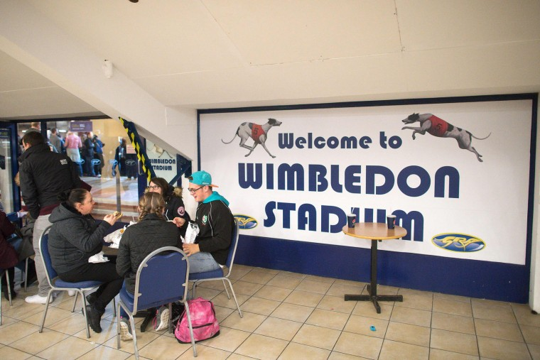 Racegoers attend an evening of greyhound racing at Wimbledon Stadium in south London on March 18, 2017. March 25 will see the final day of racing at the Wimbledon dog track which will close to be demolished to make way for a new stadium for AFC Wimbledon. The closer of track will mark the end of the once hugely popular working-class sport of greyhound racing in London. (Justin Tallis/AFP/Getty Images)