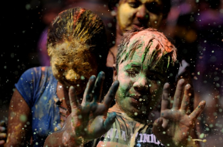Indian youth play with colors during Holi celebrations in Chennai on March 12, 2017. The Hindu festival of Holi, or the 'Festival of Colours' heralds the arrival of spring and the end of winter. (Arun Sankar/AFP/Getty Images)