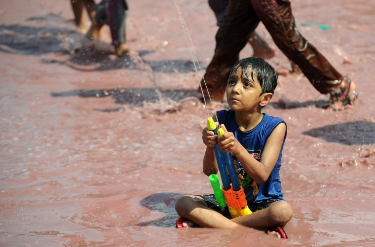 Indian children sprinkle colors during Holi celebrations in Chennai on March 13, 2017. The Hindu festival of Holi, or the 'Festival of Colours' heralds the arrival of spring and the end of winter. (Arun Sankar/AFP/Getty Images)