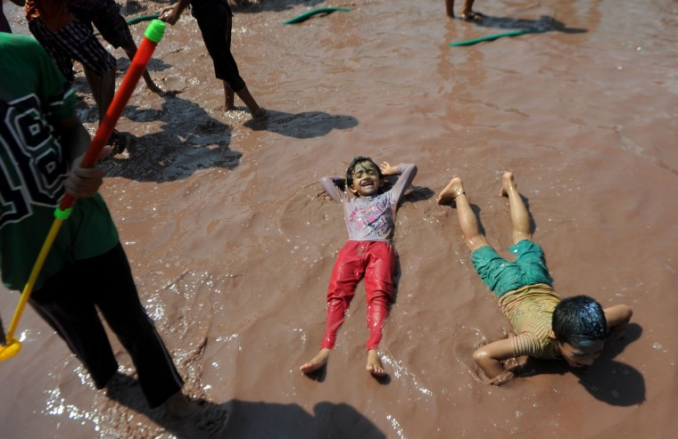 Indian children play in pools of coloured water during Holi celebrations in Chennai on March 13, 2017. The Hindu festival of Holi, or the 'Festival of Colours' heralds the arrival of spring and the end of winter. (Arun Sankar/AFP/Getty Images)