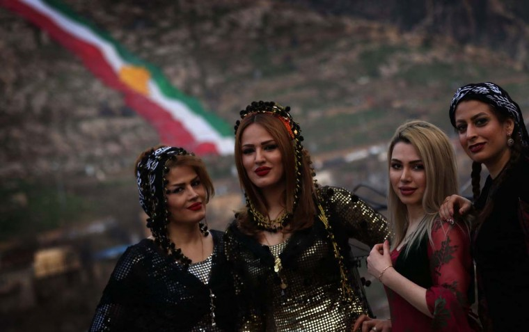 Iraqi Kurdish women dressed in traditional clothing pose for pictures in the town of Akra, 500 km north of Baghdad, on March 20, 2017 as they celebrate the Noruz spring festival. (SAFIN HAMED/AFP/Getty Images)