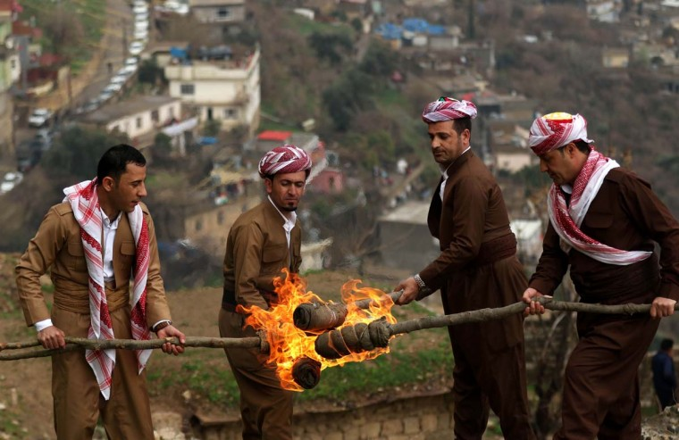 Iraqi Kurds holding lit torches walk up a mountain in the town of Akra, 500 km north of Baghdad, on March 20, 2017 as they celebrate the Noruz spring festival. (SAFIN HAMED/AFP/Getty Images)