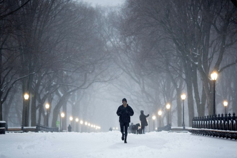Runners run in Central Park during a day of heavy snow and freezing rain on March 14, 2017 in New York City. Much of the Northeast is under a state of emergency as a blizzard is expected to bring over one foot of snow and high winds to the area. (Photo by Kevin Hagen/Getty Images)