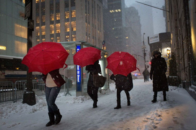 Tourists walk up Fifth Avenue during a day of heavy snow and freezing rain on March 14, 2017 in New York City. Much of the Northeast is under a state of emergency as a blizzard is expected to bring over one foot of snow and high winds to the area. (Photo by Kevin Hagen/Getty Images)