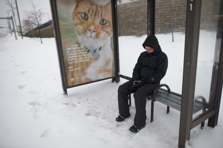 A man waits for his bus at a stop March 14, 2017 in King of Prussia, Pennsylvania. A blizzard is forecast to bring more than a foot of snow and high winds to up to eight states in the Northeast region, as New York and New Jersey are under a state of emergency. School districts across the entire region were closed and thousands of flights were canceled. (Photo by Mark Makela/Getty Images)